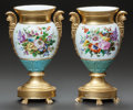 Ceramics & Porcelain, A NEAR PAIR OF PARIS PAINTED AND PARCEL-GILT PORCELAIN URNS. Late 19th/early 20th century. 12-7/8 inches high (32.7 cm). ... (Total: 2 Items)