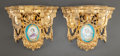 Decorative Arts, French, A PAIR OF SÈVRES-STYLE GILT BRONZE WALL BRACKETS. Late 19th/early20th century. 9 inches high (22.9 cm). ... (Total: 2 Items)