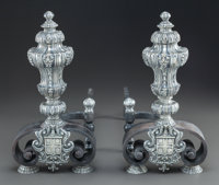 A PAIR OF BAROQUE-STYLE SILVERED BRONZE ARMORIAL ANDIRONS Early 20th century 15-1/2 x 7-5/8 x 17-1/4 inches (3