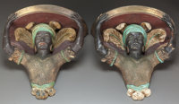 A PAIR OF POLYCHROMED CAST METAL BLACKAMOOR WALL SHELVES Early 20th century 11-1/4 inches high (28.6 cm)