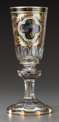 Decorative Arts, Continental, A BOHEMIAN PAINTED AND PARCEL-GILT GLASS GOBLET. 20th century. 10inches high (25.4 cm). ...