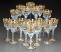 A SET OF SEVENTEEN VAL ST. LAMBERT PARCEL-GILT GLASS WINE STEMS Mid-20th century 7-1/2 inches high (19.1 cm)