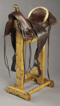 Western Expansion:Cowboy, UNMARKED ½ SEAT SADDLE ca. 1870's - 1880's - Original woodstirrups, fenders and single rear jockey; stamped with largeexpo...