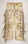 American Indian Art:Beadwork, A PAIR OF NORTHERN PLAINS OR PLATEAU PICTORIAL BEADED HIDETROUSERS. . c. 1890. ...