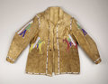 American Indian Art:War Shirts/Garments, A SIOUX PICTORIAL BEADED HIDE JACKET. . c. 1890. ...