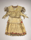 American Indian Art:War Shirts/Garments, A KIOWA BEADED AND FRINGED HIDE DRESS. . c. 1880. ...