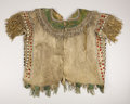 American Indian Art:War Shirts/Garments, AN APACHE BEADED HIDE SHIRT. . c.1880. ...