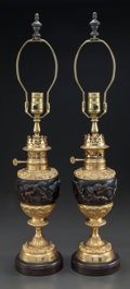 Decorative Arts, French, A PAIR OF FRENCH PARCEL-GILT BRONZE URNS MOUNTED AS LAMPS. 20thcentury. 27-1/4 inches high (69.2 cm). PROPERTY FROM A PRI...(Total: 2 Items)