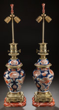 Asian:Japanese, A PAIR OF JAPANESE IMARI PORCELAIN AND GILT BRONZE JARS MOUNTED ASLAMPS. 20th century. 32 inches high (81.3 cm). PROPERTY... (Total:2 Items)