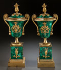 Decorative Arts, French, A PAIR OF LOUIS XVI-STYLE MALACHITE AND GILT BRONZE MOUNTED COVEREDURNS. 20th century. 16-1/2 inches high (41.9 cm). ... (Total: 2Items)