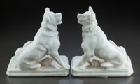 A PAIR OF CARVED ALABASTER SEATED DOGS 20th century 11-1/2 inches high (29.2 cm)