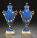 Decorative Arts, French, A PAIR OF LOUIS XVI-STYLE FAUX LAPIS AND GILT BRONZE MOUNTED URNS. 20th century. 16 inches high (40.6 cm). ... (Total: 2 Items)