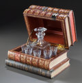 Decorative Arts, French, A BACCARAT DECANTER SET IN A LEATHER FAUX BOOK-FORM CASE. 20thcentury. Marks to glassware: BACCARAT, FRANCE. 8-3/4 x 11...
