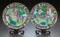 Asian:Chinese, A PAIR OF CHINESE FAMILLE NOIRE PORCELAIN PLATES WITH STANDS. 19thcentury. 9-1/2 inches diameter (24.1 cm). ... (Total: 2 Items)
