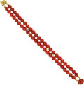 Estate Jewelry:Bracelets, A CORAL, GOLD BRACELET. The double strand bracelet is composed ofcoral beads measuring approximately 7.00 mm, completed by ...