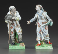 A PAIR OF GINORI PORCELAIN FIGURINES 19th century Marks: N (under crown) 6-1/2 inches high (16.5