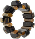 Estate Jewelry:Bracelets, A BLACK AND BUTTERSCOTCH BAKELITE BRACELET. Strung on black elasticcord. Gross weight 94.95 grams.. PROPERTY SOLD TO BENE...