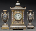 Paintings, AN ORIENTALIST PATINATED, SILVERED AND GILT BRONZE THREE-PIECE CLOCK GARNITURE. Early 20th century. Marks: 2018 (to urns... (Total: 3 Items)