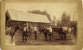 "Photography:Cabinet Photos, COWBOYS ""MOUNT UP"" - BOUDOIR CARD - ca. 1880-90. Four cowboys areabout to mount their horses, while in front of a rickety r...(Total: 1 Item)"