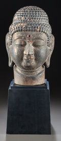 Miscellaneous, A CARVED WOOD HEAD OF BUDDHA WITH BASE. Circa 1900. 12-1/2 incheshigh (31.8 cm) (without base). ...