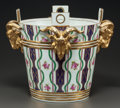 Ceramics & Porcelain, A SÈVRES-STYLE PARCEL-GILT FIGURAL JARDINIÈRE. 20th century. Marks: (interlaced L marks). 14-3/8 inches high x 17-3/8 inches...