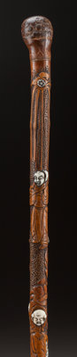 A IVORY AND WOOD CHINESE FABLE CANE Circa 1900 34-1/4 inches overall length (87.0 cm)  The cane with car