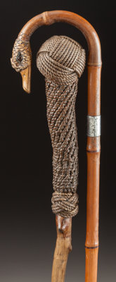 A NAUTICAL ROPE AND WOOD CANE WITH A SILVER AND WOOD DUCK CANE Circa 1900 Marks to duck cane: (lion passant)
