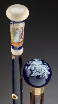 AN ENAMEL, GLASS AND WOOD CANE WITH A PORCELAIN, IVORY AND WOOD CANE Circa 1900 36 x 35-1/4 inches overall le