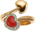Jewelry, A CORAL, DIAMOND, WHITE AND YELLOW GOLD BYPASS RING. The ring features a heart-shaped coral cabochon, enhanced by full-cut d...
