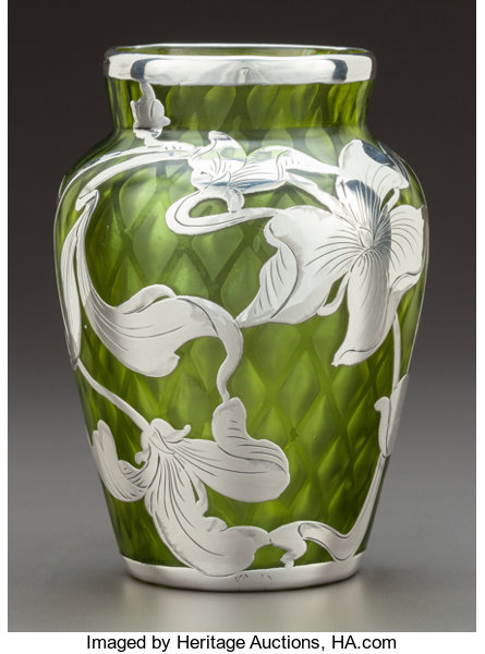 A Steuben Green Quilted Glass Vase With La Pierre Silver Overlay