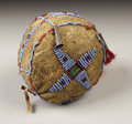 American Indian Art:Beadwork, A PLAINS BEADED HIDE SHINNY BALL. . c. 1890. ...