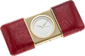 Estate Jewelry:Other , A YELLOW METAL, LEATHER TRAVEL CLOCK, TIFFANY & CO.. Case: Goldmetal, burgundy lizard skin. Dial: White with luminescent ha...