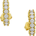 Estate Jewelry:Earrings, A PAIR OF DIAMOND, GOLD EARRINGS. The earrings are designed ashoops and feature full-cut diamonds weighing a total of appro...