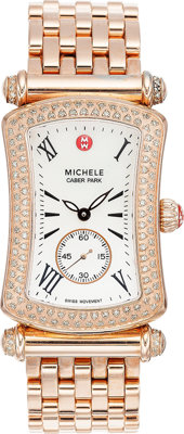 A MICHELE LADY'S PINK METAL CABER PARK DIAMOND WRISTWATCH The watch features a mother-of-pearl dial, bezel-set wit