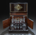Decorative Arts, French, A LOUIS PHILIPPE MAHOGANY, BRASS AND MOTHER-OF-PEARL INLAID LIQUEURSET. Circa 1840. 10 x 12-3/4 x 9-1/2 inches (25.4 x 32.4...