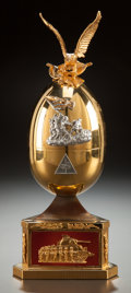 Decorative Arts, Continental, A THEO FABERGÉ GILT AND ENAMELED SILVER VICTORY EGG. Circa2000. Marks: (lion passant), (anchor), 925, TF, g. 11...(Total: 2 Items)
