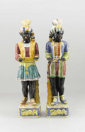 Decorative Arts, Continental, A Pair of Italian Majolica glazed Blackamoor Figures. . Mid.20th Century. Italy. 43 inches (109.2 cm). ... (Total: 2 Items)