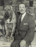 "Movie/TV Memorabilia:Autographs and Signed Items, Walt Disney Signed Photo. This great b&w 11"" 14"" photo ofanimation and family entertainment icon Walt Disney with his petb... (Total: 1 Item)"