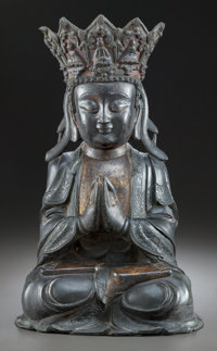 A MING DYNASTY BRONZE AND POLYCHROMED SEATED BUDDHA Chinese 21-3/4 inches high (55.2 cm)