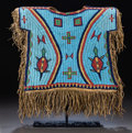 American Indian Art:Beadwork and Quillwork, A SIOUX BOY'S PICTORIAL BEADED AND FRINGED HIDE SHIRT. c. 1875...