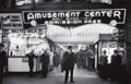 Photographs:20th Century, PETER STACKPOLE (American, 1913-1997). Sailors and CiviliansOutside a Brightly Lit Times Square Arcade During WWII, 194...