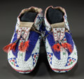 American Indian Art:Beadwork and Quillwork, A PAIR OF SIOUX BEADED HIDE CEREMONIAL MOCCASINS. c. 1890...