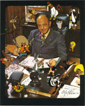 "Movie/TV Memorabilia:Autographs and Signed Items, Mel Blanc Signed Photo. A great color 8"" x 10"" photo of voice actorMel Blanc at his desk with many of the cartoon character... (Total:1 Item)"