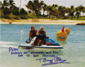 """Movie/TV Memorabilia:Autographs and Signed Items, Buzz Aldrin Signed Photo to Peter Fonda. A color 8"""" x 10"""" photo ofpeter Fonda riding a jet ski with former astronaut Buzz A...(Total: 1 Item)"""