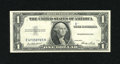 Error Notes:Obstruction Errors, Fr. 1614 $1 1935E Silver Certificate. Extremely Fine-AboutUncirculated.. ...