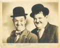 Movie/TV Memorabilia:Autographs and Signed Items, Laurel and Hardy Signed Photo. This is the Stan and Ollie portrait that most of their fans prefer - the world's most belove... (Total: 1 Item)
