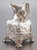 Silver & Vertu:Hollowware, A GERMAN SILVER REPOUSSÉ WATER PITCHER . Circa 1900. Marks: 800, (crescent-crown). 9-1/8 x 6 x 6-3/4 inches (23.2 x 15.2...