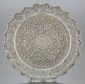 Silver Holloware, Continental, AN INDIAN SILVER RETICULATED FOOTED TRAY . Circa 1900. Unmarked. 1inch high x 12 inches diameter (2.5 x 30.5 cm). 22.4 ounc...
