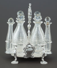 A PAUL STORR GEORGE IV SILVER CRUET STAND WITH CUT GLASS BOTTLES Paul Storr, London, England, circa 1824-1825 M