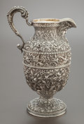 Silver Holloware, American:Water Pitchers, A KIRK & SON CO. SILVER AND SILVER GILT REPOUSSÉ WATER PITCHER. Samuel Kirk & Son Co., Baltimore, Maryland, circa 1900.Mar...
